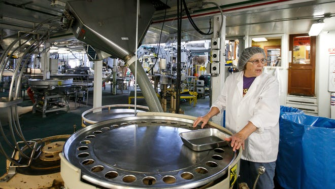 Ardis Birch points out equipment in the Oregon Fruit Products warehouse on Thursday, July 6, 2017, in Salem, Ore. Birch recently retired after working for the company for 56 years; she has worked nearly every job at the plant, from sorting fruit to labelling and shipping.