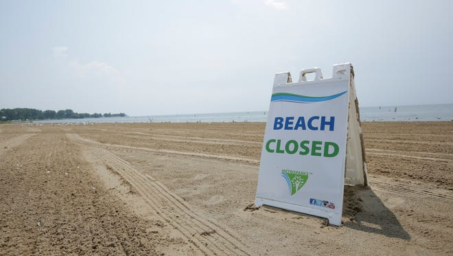 Metropark Beach is closed due to high bacteria levels in Lake St. Clair in Harrison Township, Thursday, August 3, 2017.