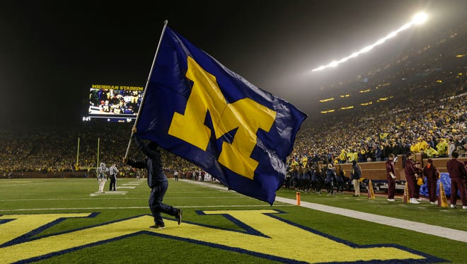 The Michigan flag is flown during the second half at Michigan Stadium on Nov. 4, 2017.