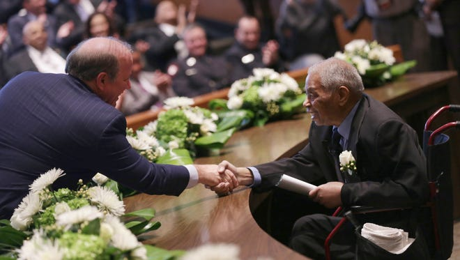 Detroit Mayor Mike Duggan shake hands with Judge Damon Keith after being sworn in during a ceremony at the Coleman A. Young Municipal Center in Detroit on Tuesday, January 9, 2018.