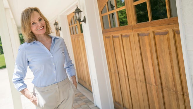 Ellen Haring, former Mansfield city council member, recently transformed a five-car showroom garage into a guest house on her property south of town.