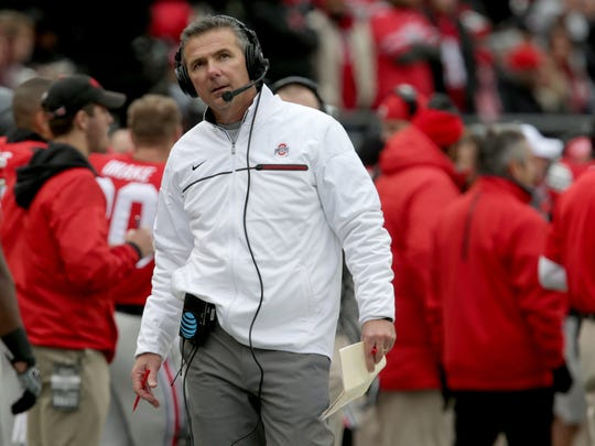 Ohio State coach Urban Meyer looks up at the scoreboard during the first half against the University of Michigan at Ohio Stadium on Saturday, Nov. 26, 2016.