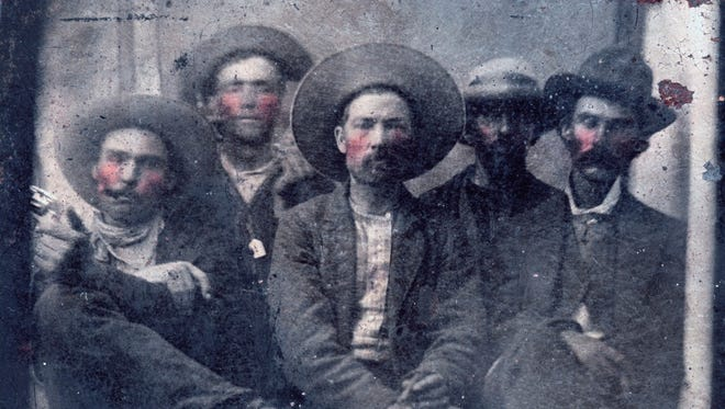 This photo provided by Frank Abrams shows what historians believe is a photo of outlaw Billy the Kid, second from left, and Pat Garrett, far right, taken in 1880. Frank Abrams, who bought the photo at a flea market says experts in forensics and facial recognition have verified the picture after several months of examination.