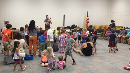 Musician Andy Mason performed for kids at the annex in the Carlsbad Public Library. The event was one of 41 summer programs offered by the library.