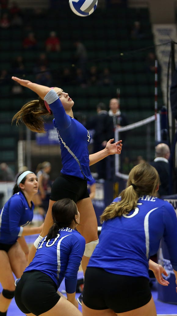 Haldane's Brooke Vahos goes up for a spike during the Blue Devils' victory over Tioga in the Glens Falls Civic Center Saturday. Haldane advanced out of pool play to reach Sunday's final against defending champ Portville.