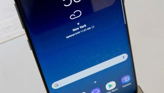 The Samsung Galaxy S8 is on display after a news conference, Wednesday, March 29, 2017, in New York. The Galaxy S8 features a larger display than its predecessor, the Galaxy S7, and sports a voice assistant intended to rival Siri and Google Assistant.