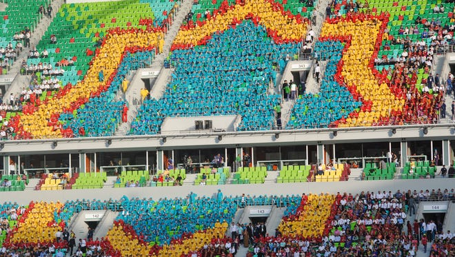 The 8-pointed star, one of the icons of Turkmenistan, is outlined by people in one section of the stands during the closing ceremonies of the 5th Asian Indoor & Martial Arts Games.