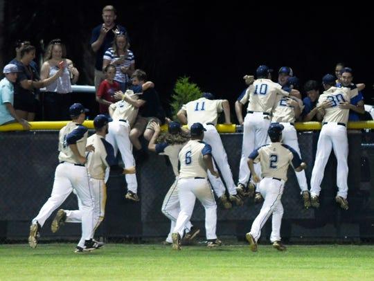 Eau Gallie players celebrate their victory over Port