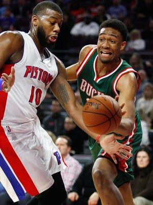 Milwaukee Bucks forward Jabari Parker (12) defended by Detroit Pistons forward Greg Monroe (10) during the first quarter at The Palace of Auburn Hills.