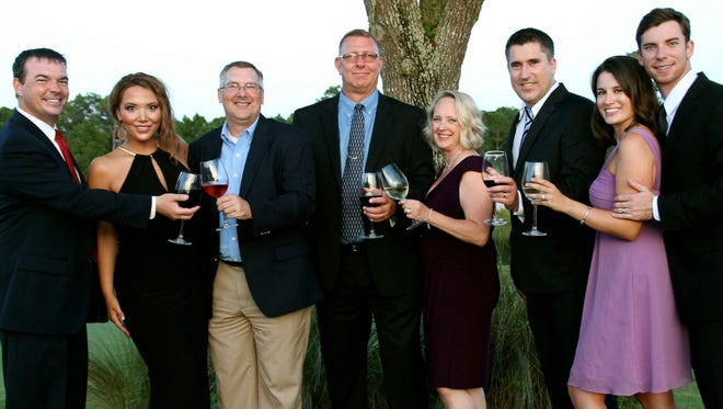 Travis Walker (from left), Shawna Taylor, Jeff Emmeluth, Chris and Jessica Powers, Tim Taylor and Rebecca and Kori Benton.