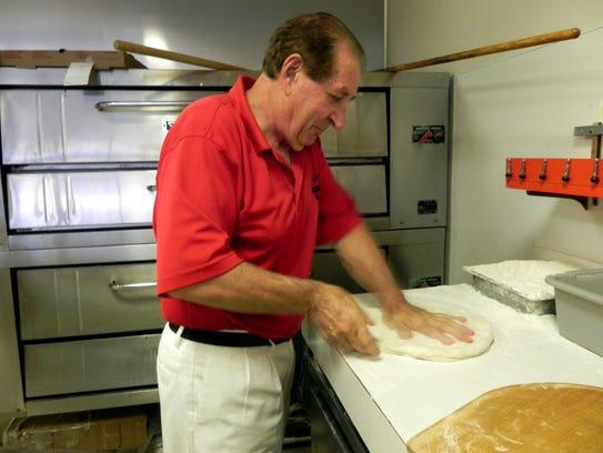 Erminio Iantosca prepares to hand-toss fresh dough