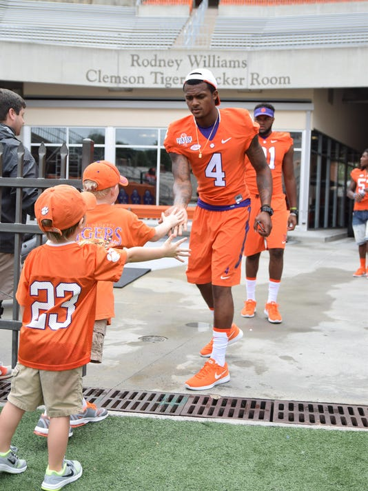 Deshaun Watson greets two young fans at Death Valley Sunday before Fan Day