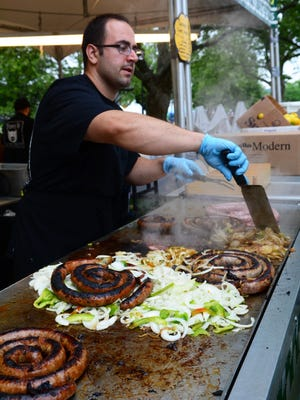 Riverfest returned to Marine Park in Red Bank Friday Saturday and Sunday. The annual event featured a beer garden, food, music, vendors and activities. Paul Bannoa works the grill at Tony's Sausage.