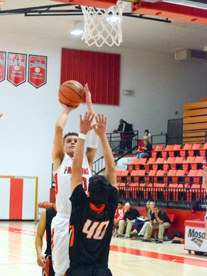 Loving's Alex Gonzalez puts up a shot in the quarter against Capitan on Monday.