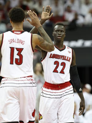 U of L's Deng Adel (22), right, and Ray Spalding (13) celebrated a play against North Carolina during their game at the Yum Center.    Feb. 17, 2018