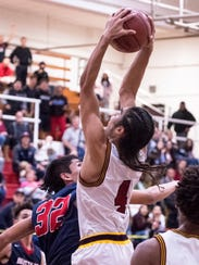 Tulare Union's Darius Baker grabs a rebound to secure