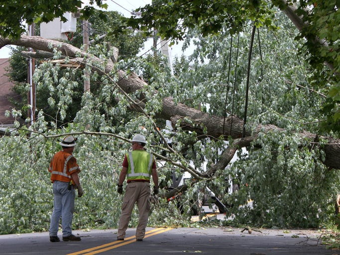 Washington Road in Sayreville was closed to traffic after a tree and power lines are removed. The tree and power lines were brought down after high winds uprooted a tree along the side of the roadway during a late night storm on Tuesday, July, 8.