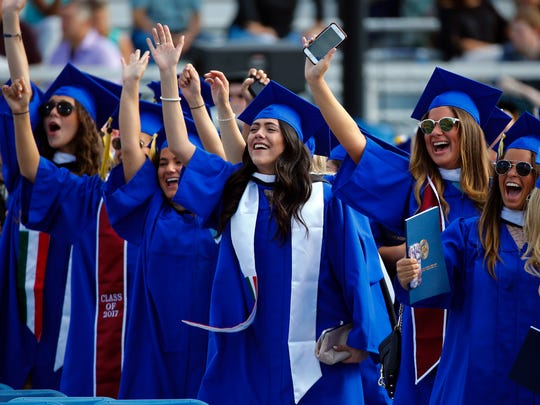 Students find familiar faces in the crowd as the University of Delaware holds its 168th Commencement, honoring 5,883 undergrad and graduate degree recipients Saturday at Delaware Stadium.
