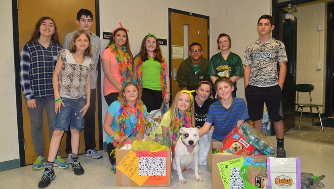 Pittsgrove Township Middle School students are joined by Cookie, a dog available for adoption from the Cumberland County SPCA. The students collected money and other donations for the SPCA.