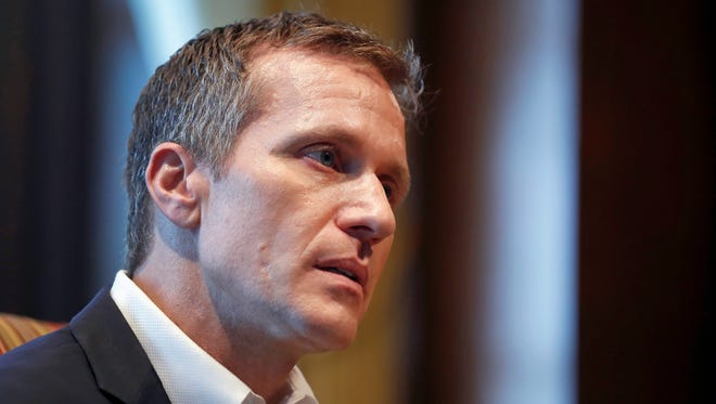 FILE - In this Jan. 20, 2018, file photo, Missouri Gov. Eric Greitens listens to a question during an interview in his office at the Capitol in Jefferson City, Mo., where he discussed having an extramarital affair before taking office.