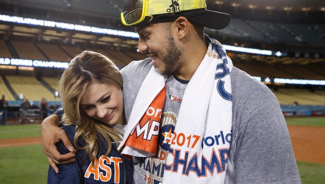 Carlos Correa and Daniella Rodriguez on the field at Dodger Stadium after Game 7.