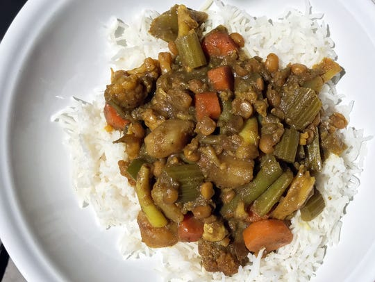 Vegetable Curry served over steamed Basmati Rice combines