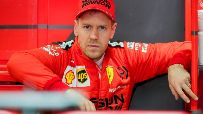 Scuderia Ferrari Mission Winnow's Sebastian Vettel stands at his box during the Formula One pre-season testing session at the Barcelona Catalunya racetrack in Montmelo, outside Barcelona, Spain, Friday, Feb. 21, 2020.