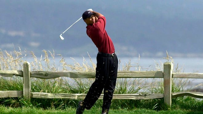 From June 18, 2000, Tiger Woods tees off on the 18th hole on his way to winning the 100th U.S. Open Golf Championship at the Pebble Beach Golf Links in Pebble Beach, Calif. Golf Channel is airing a one-hour special on May 24 of Woods winning all four majors in a span of 10 months.