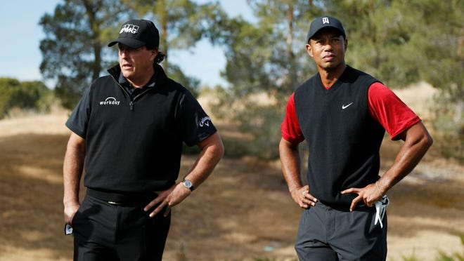 Phil Mickelson, left, and Tiger Woods stand at the first tee before a golf match at Shadow Creek golf course, Friday, Nov. 23, 2018, in Las Vegas.
