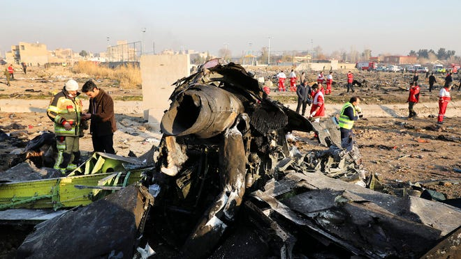 "Debris is shown Wednesday at the scene where a Ukrainian plane crashed in Shahedshahr southwest of the capital Tehran, Iran. Two U.S. officials said Thursday that it was ""highly likely"" that an Iranian anti-aircraft missile downed a Ukrainian jetliner late Tuesday, killing all 176 people on board. President Donald Trump is suggesting he believes Iran was responsible."