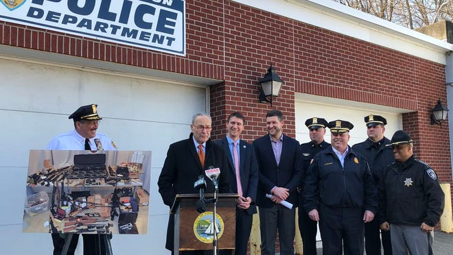 U.S. Sen. Charles Schumer, second from left, discusses the need to close loopholes in federal firearms definitions at a press conference at the City of Kingston Police Department station Monday afternoon. He was joined by law enforcement leaders from Newburgh, Middletown and Kingston.