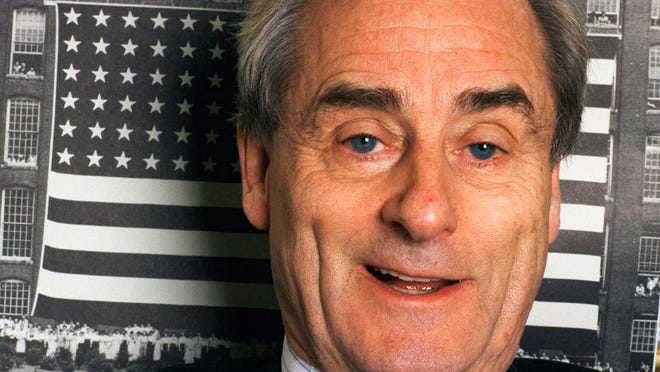 """In this Nov. 18, 1998 file photo, journalist Harold Evans talks about his new book, """"The American Century,"""" at his office in New York. Evans, the charismatic publisher, author and muckraker, has died at 92. His wife, fellow author-publisher Tina Brown, said he died of congestive heart failure, it was reported on Thursday, Sept. 24, 2020. He was a bold-faced name for decades, from exposing wrongdoing in 1960s London, to publishing such 1990s best-sellers as Joe Klein's """"Primary Colors."""""""