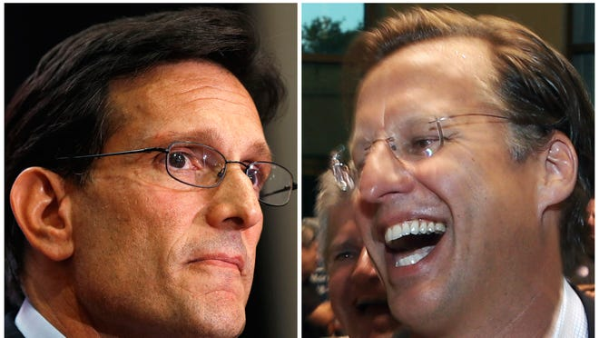 House Majority Leader Eric Cantor, R-Va., left, and Dave Brat, right, react after the polls close on June 10 in Richmond, Va. Brat defeated Cantor in the Republican primary.