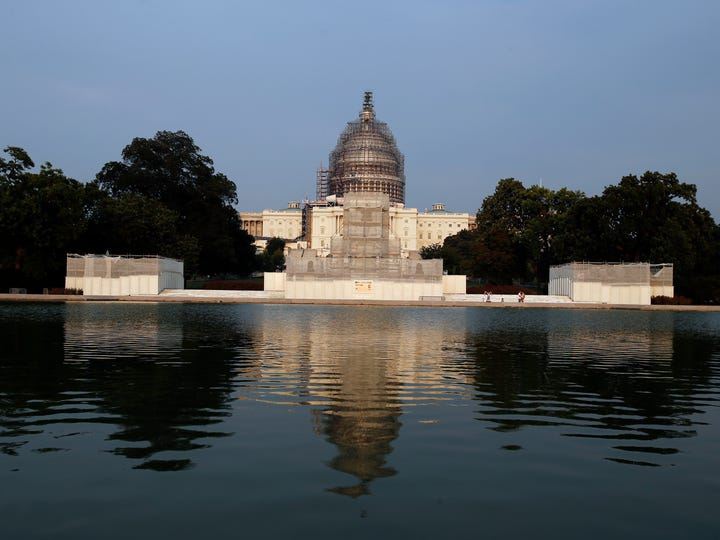 The west front of the U.S. Capitol is seen under repair