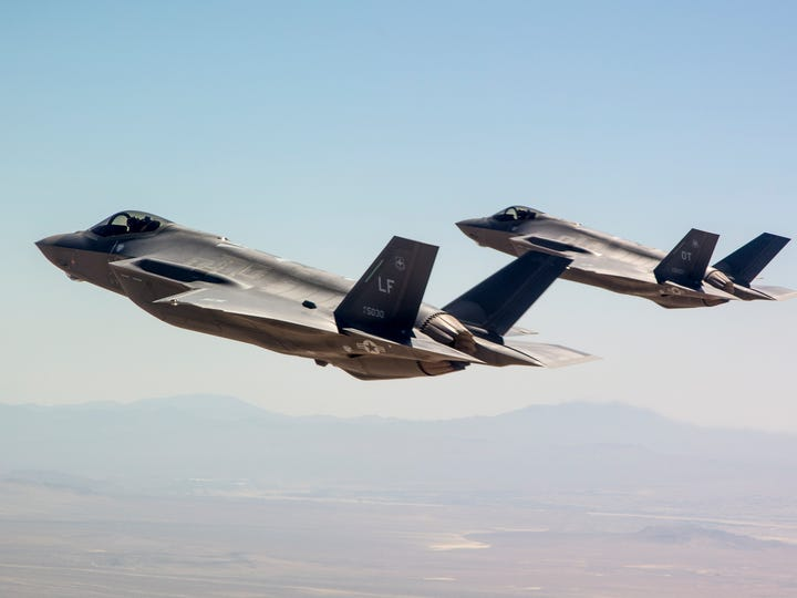 Two F-35s fly in formation during a 2014 demonstration.