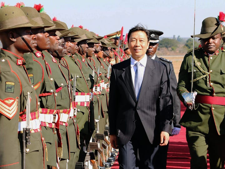 Chinese Vice President Li Yuanchao inspects an honor