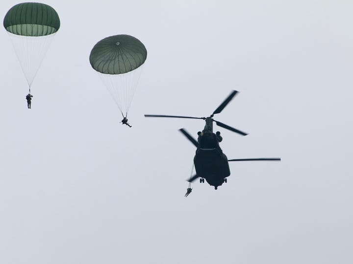 US paratroopers jump from a Canadian CH-147 piloted