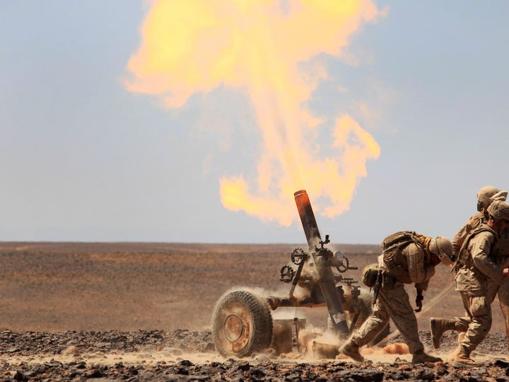 Marines fire a 120 mm towed mortar system called the