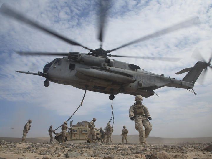 Marines prepare a Humvee for transport via sling load