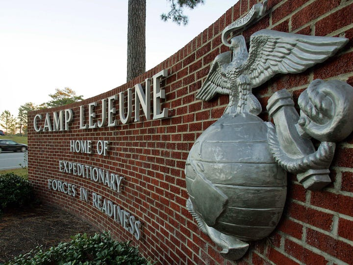 Cars enter the main gate at Camp Lejeune in Jacksonville,