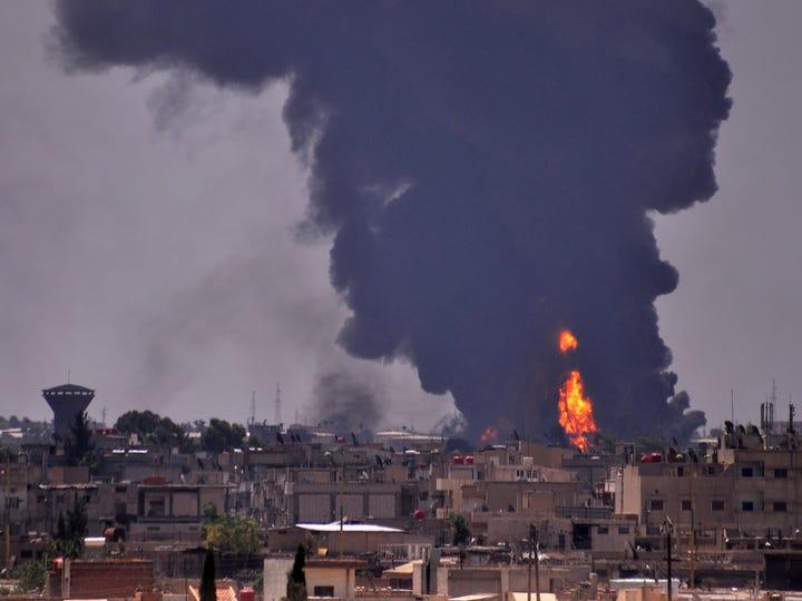 Smoke billows in the northeastern Syrian city of Hasakeh