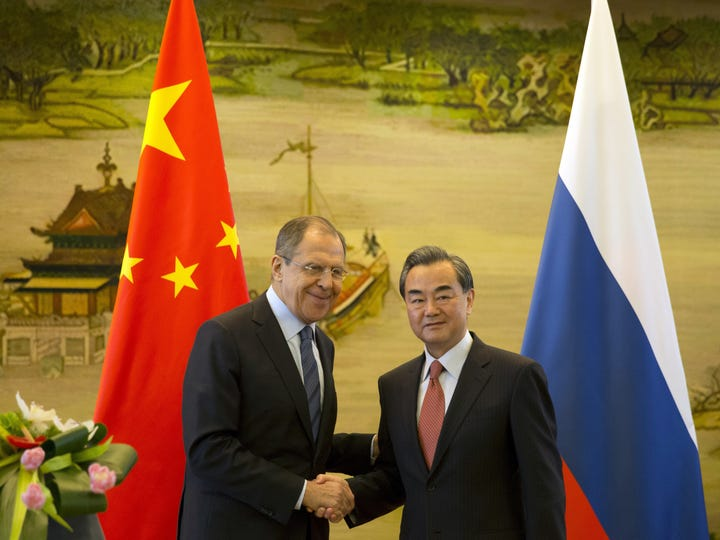 Russian Foreign Minister Sergey Lavrov, left, and Chinese