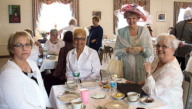 Millville Woman's Club members, (seated from left), Karen De Santis, Sharron Mosely and Pat Moore, talk with fellow member Barbara Scudder (standing) at the club's Victorian Tea, which was held March 25 at the clubhouse. The event attracted a capacity crowd. Entertainment was provided by the club's chorus.