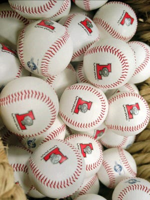 """A basket of baseballs with the Lugnuts logo are for sale at the  """"Nuts and Bolts"""" store at the stadium in  Lansing, Mich., April 4, 1996.LJ201"""
