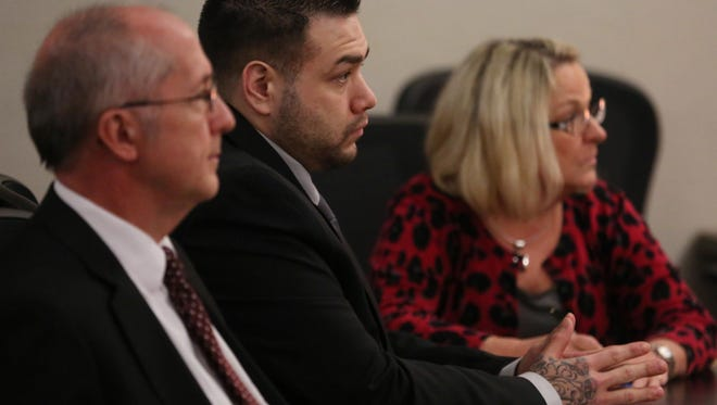 Pete Polson listens to the jury's verdict Wednesday Oct. 21, 2015, in his attempted murder trial at the Polk County Courthouse in Des Moines.