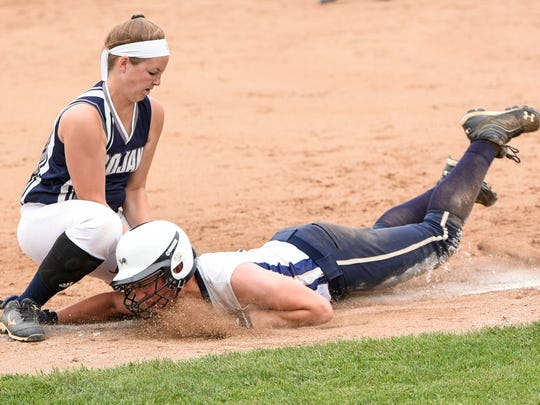 Chambersburg's Tara Harmon tags out Penn Manor runner Morgan Yingling at third base during the District 3 Class AAAA softball championship game played at Lebanon Valley College on Thursday, June 2, 2016. Chambersburg defeated Penn Manor 1-0 in 10 innings.