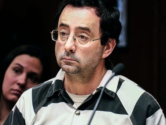 Larry Nassar listens to testimony of a witness during