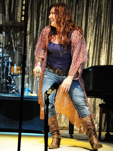 Jo Dee Messina shares a joke with her audience Saturday night at the Millersport Sweet Corn Festival. Messina's concert closed out the festival. For more photos form the concert visit LancasterEagleGazette.com.