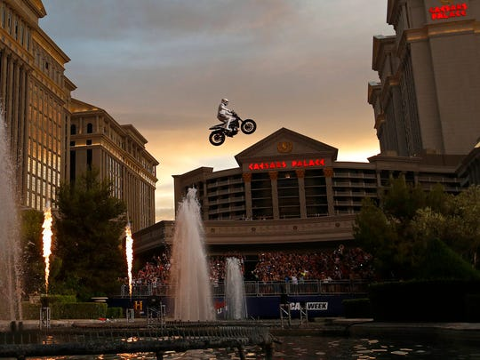 Travis Pastrana jumps the fountain at Caesars Palace on a motorcycle Sunday, July 8, 2018, in Las Vegas.