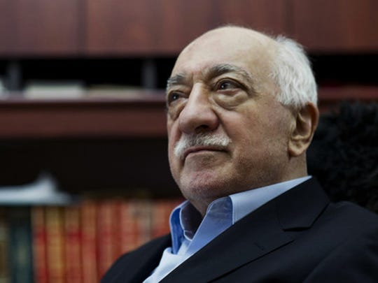 In this March 15, 2014, file photo, Turkish Muslim cleric Fethullah Gulen, sits at his residence in Saylorsburg, Pa.. A U.S.-based Muslim cleric, who has become Turkish President Recep Tayyip Erdogan's chief foe, went on trial in absentia in Istanbul on Wednesday,  Jan. 6, 2016 accused of attempting to overthrow the government by instigating corruption probes in 2013 that targeted people close to the Turkish leader.
